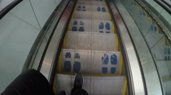 4K First person view of feet going down an escalator Stock Footage