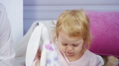 Little girl playing with toy Stock Footage