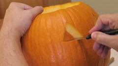Man Carves a Jack 'o' Lantern Stock Footage