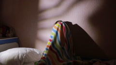 Girl under the covers in the night afraid of ghosts. nightmares. Stock Footage