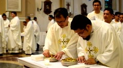Roman Catholic priests line up to have communion Stock Footage
