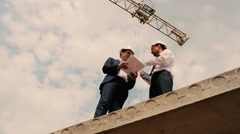 Two foremen are swearing at the building site Stock Footage