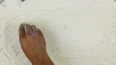 Young man writes a word gluten on white flour Stock Footage