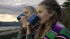 Hikers Chat, Laugh, Drink From Camping Mugs, One Points To Something In Distance Stock Footage