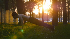 Close up of sportsman training outside with beautiful sunrise at background Stock Footage
