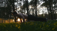 Young man workout in the  city park at sunset. Slow motion Stock Footage