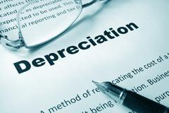 Paper with sign Depreciation and a pen. Business concept. Stock Photos