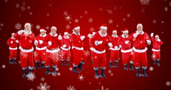 Group of santa claus dancing on a snowy landscape Stock Footage