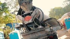 Heavy truck merges cement in an iron basket Stock Footage