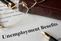 Unemployment Benefits concept written on a paper. Stock Photos