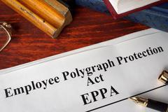 Employee Polygraph Protection Act EPPA and a book. Stock Photos
