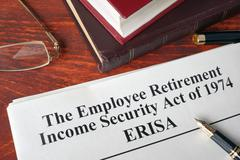 ERISA The Employee Retirement Income Security Act of 1974  on a table. Stock Photos