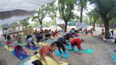 Group hatha yoga on ethno esoteric festival Stock Footage