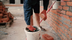 The worker build brick wall at construction site Stock Footage