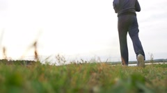 Man outdoors playing sports yoga gymnastics healthy sport lifestyle Stock Footage