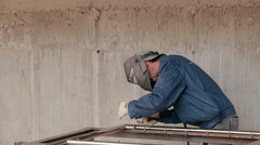 The builder welds the pipe at construction site Stock Footage