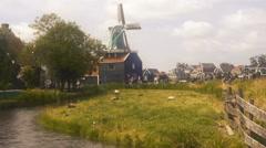 Zaandam mills on the water channel in zaanstad village, Netherland. Holland Stock Footage