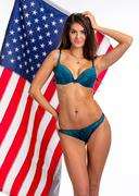 Pretty Slim woman in beautiful lingerie on US flag Kuvituskuvat