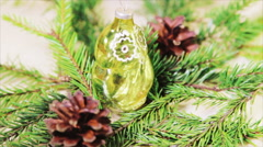 Glass owl and pine cones on the fir branches. Stock Footage