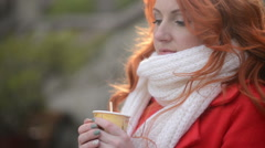 Woman drinking hot coffee, cold autumn day Stock Footage