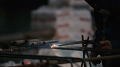 Close-up: the man welding the pipe Stock Footage