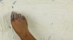 Young man writes a word pizza on white flour Stock Footage