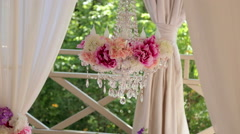 Crystal chandelier with flowers on wedding ceremony. Wedding arch. Stock Footage