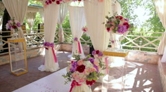 Wedding arch of four columns with floral compositions on columns. Stock Footage