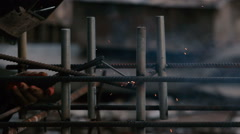 Close-up: man welding a pipe to the construction Stock Footage