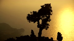 Silhouette of trees at Monolithos Castle in the dusk. Rhodes, Greece Stock Footage