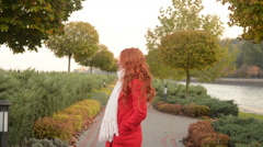 Beautiful woman in autumn park, a cool windy day Stock Footage