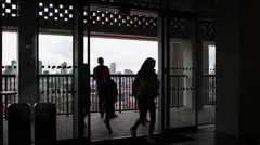 Tourists stand on the viewing gallery of the Tate Modern  extension Stock Footage