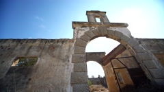 Ruin of a old silk factory in Rhodes, Greece with the sun in the background Stock Footage