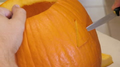 Man Carves a Face in a Pumpkin Stock Footage