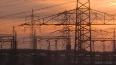 Power poles in a sunset in germany Stock Footage