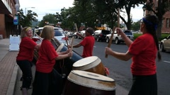 A drum corps performing on the street downtown Stock Footage