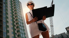 The woman looking at the building Stock Footage