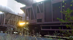 Freight wagons with ore in the background of the sun Stock Footage