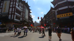 Chenghuangmiao street with travelers and pagoda style buildings. The City God Te Stock Footage
