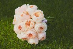 Wedding bouquet of the bride at the grass Stock Photos