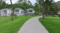 View of Modern Villa, Garden With Palm Trees and Lawn Stock Footage