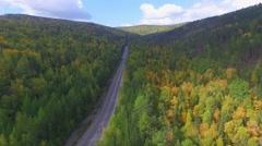 Video drone aerial view over the road in the forest on the way to Lake Baikal Stock Footage