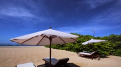 Nusa Dua luxury tropical resort. Beach with umbrellas, deck chairs, white sand Stock Footage