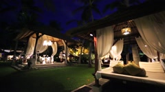 Nusa Dua luxury tropical resort. Massage and spa gazebo near the beach at night Stock Footage