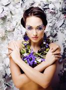 Floral face art with anemone in jewelry, sensual young brunette Stock Photos