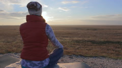 Beautiful girl meditates in savannah Stock Footage