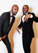 Two afro-american businessmen in black suits emotional posing, g Stock Photos