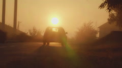 The car goes towards sunrise. Dawn in the city. Stock Footage