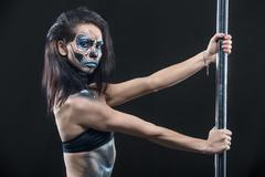 Pole dancer with body-art in dark studio Stock Photos
