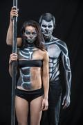 Couple of dancers with body-art Stock Photos
